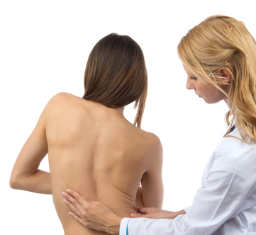 Doctor examing womans curved spine